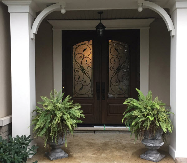 Front door with glass and intricate detailing from our windows and doors company